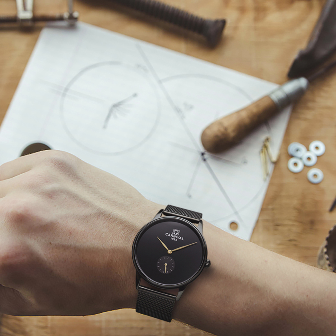 Close up of human hand and craft tools, a watch maker.
