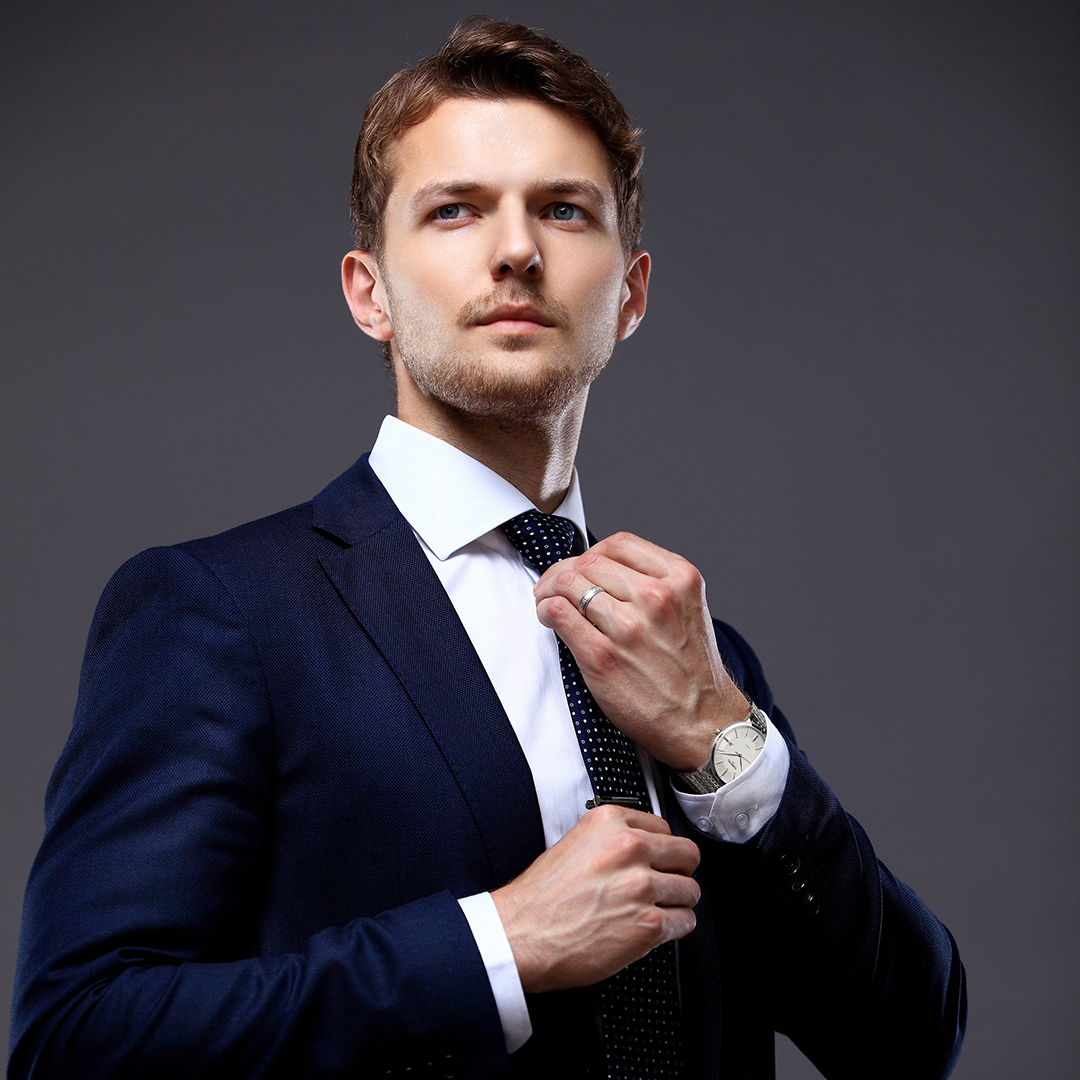 Cool businessman standing on grey